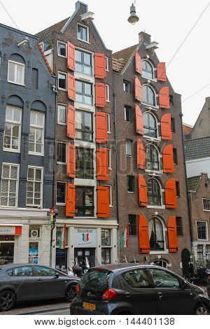 Amsterdam the Netherlands -October 03 2015: Old style building with shutters in historic city centre