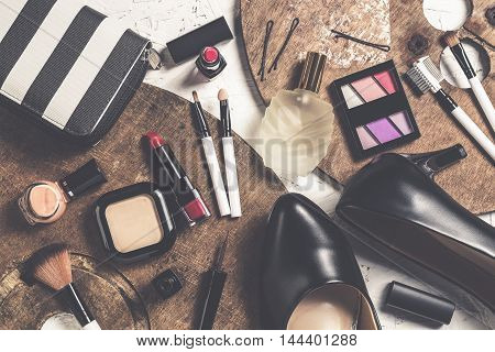 Overhead view of essential beauty items Top view of cosmetics and female accessories
