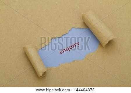 Enquiry word written under torn paper .