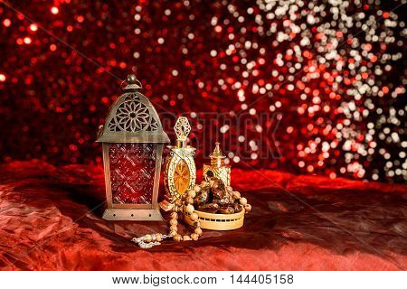 Eid and Ramadan theme background with coloured lanterns and dates with perfume bottles against a glitter backdrop