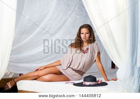 Young woman relaxing at summer lounge