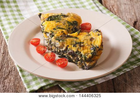 Slices Of Frittata With Spinach, Cheese And Mushrooms On A Plate Close-up. Horizontal