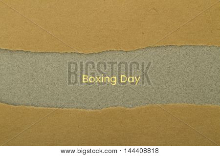 Boxing day written under torn paper .