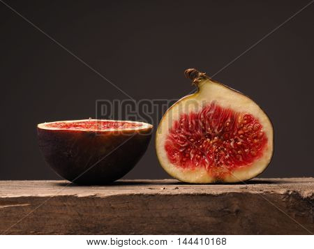 Fresh organic figs on a rustic wooden table