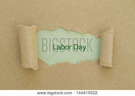 Labor Day written under torn paper. 1st May - Labor Day.