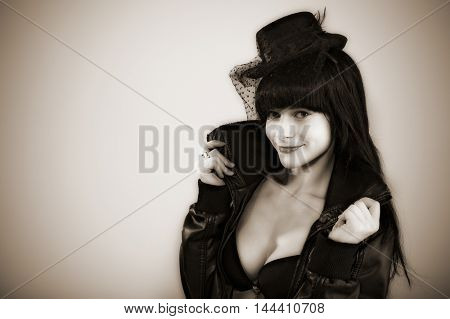 portrait of attractive young woman in black hat