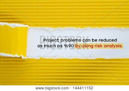 Project problems can be reduced as much as %90 by using risk analysis message written under torn paper.