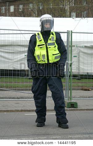 Police officer near Bronze Soldier in Tallinn Estonia 26.04.07