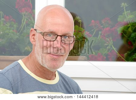 a portrait of a mature man with glasses