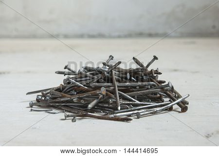 Pile of old rusty nails. Home renovation work.
