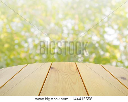 Wooden table on abstract green nature background