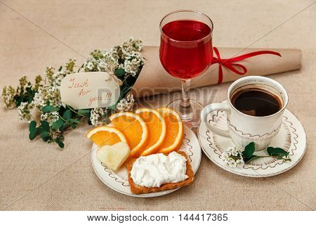 Romantic Breakfast.Cup of Coffee,Cut OrangeBiscuit with Cottage Cheese.Glass of Red Drink.Wish Card with Flowers.Congratulation Poscard