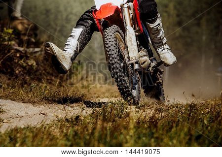 racer on a race bike during a competition at Enduro
