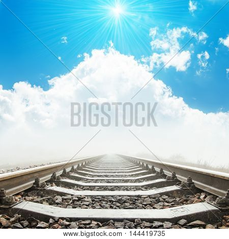 railway to heaven in clouds and sun over it