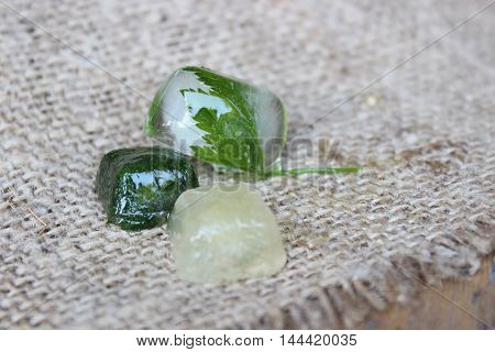 Ice cubes with parsley lying on sacking
