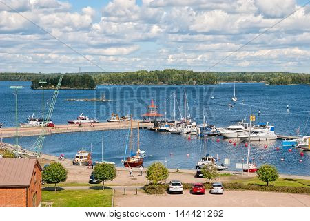 LAPPEENRANTA, FINLAND - AUGUST 8, 2016: Top view of The Saimaa Lake with boats, yachts and pavilion on the small pier.
