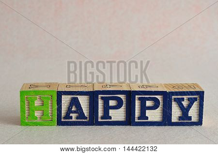 The word happy spelled with colorful blocks isolated on a white background