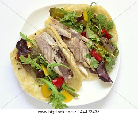Tacos with chicken and vegetable salad, top view