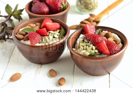 Healthy eating: creamy cottage cheese strawberries almonds seeds
