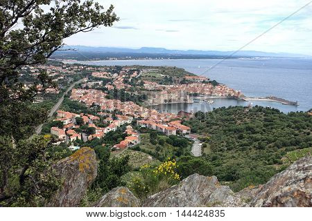 Collioure France - June 16 - 2016:The bay of Collioure with fortified church of Notre-Dame des Anges Southern France. Seen from the mountains.
