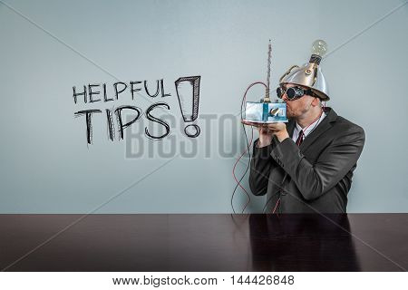 Helpful tips text with vintage businessman kissing machine
