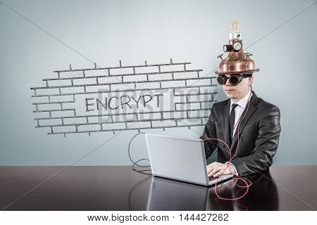 Encrypt concept with vintage businessman and laptop at office