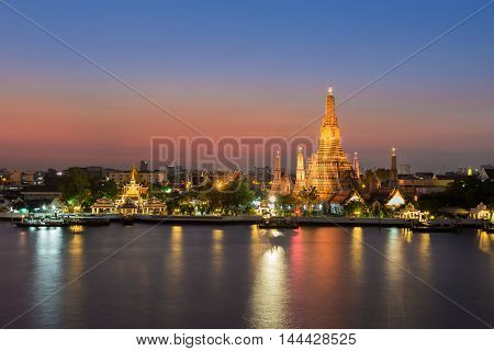 Temple of Dawn called Wat Arun river front with beauty sunset background, Thailand most famous landmark