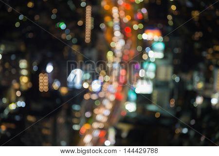 Aerial view blurred bokeh lights Tokyo city road, Japan