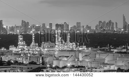 Black and White, Oil refinery light night with city downtown background