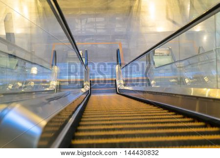 Empty escalator going down with motion blur.