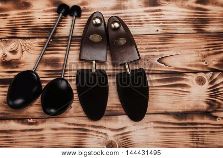 Two Pairs Of Shoetree On The Vintage Background Fired Wood