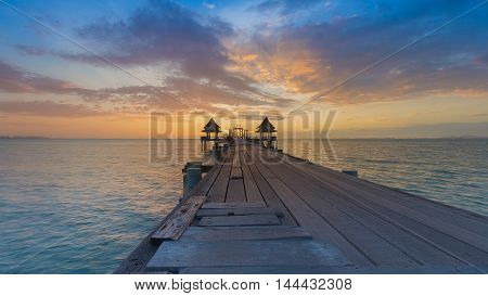 Wooden walkway leading to ocean skyline with beautiful sky background