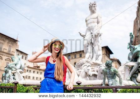 Young female traveler having fun near famous Neptun fountain in Florence. Having great vacations in Florence