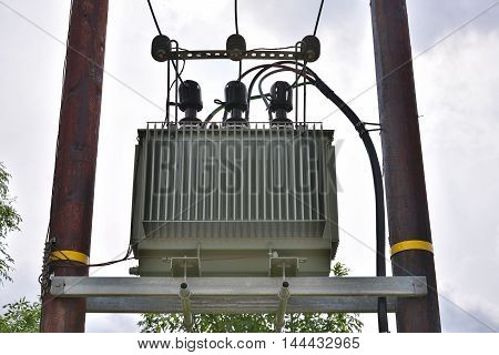 Utility pole with electricity transformer - power generation industry