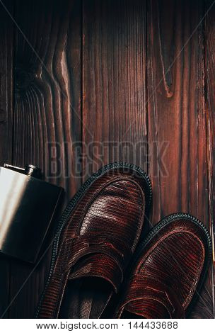 Mocasine Shoes Of Snake Skin And Stainless Flask On The Woden