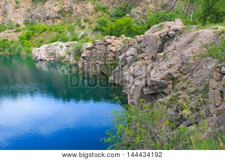 Lake at the abandoned quarry on summer