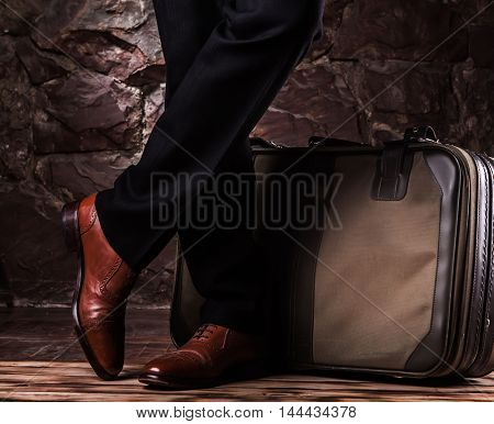 Standing Leg On The Balck Classikal Trousers And Brown Oxfords.c