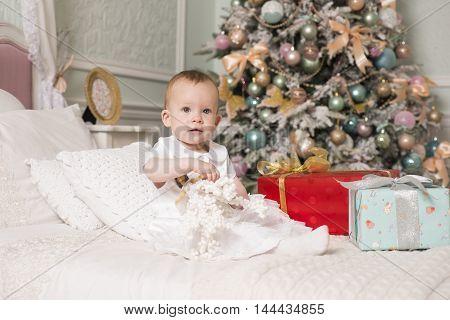 Little Princess next to the Christmas tree