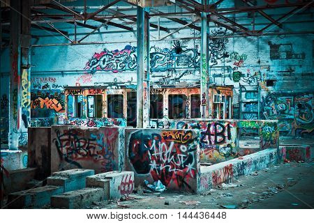 picture of an old building. a building shrouded in mystery. colored walls