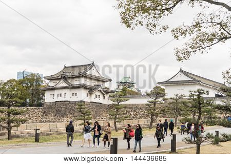 Osaka, Japan - March 11, 2016: Osaka on MArch 11, 2016. Tourists are entering Osaka Castle at the front Entrance.