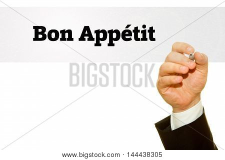 Hand writing Bon Appetit on a transparent wipe board. Enjoy your meal in French Language.