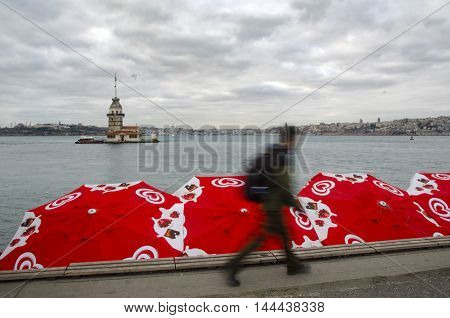 Istanbul Turkey - December 04 2013: Maidens Tower view over ice cream umbrellas in the Algida. European part of Istanbul in the background against the shore. Left Blue Mosque medium Hagia Sophia Topkapi palace dome seem right. The Maiden's Tower (Turkish: