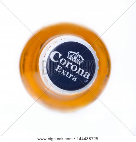 CHISINAU MOLDOVA - December 15 2015: Photo of a bottle of Corona Extra Beer top view. Corona produced by Grupo Modelo with Anheuser Busch InBev is the most popular imported beer in the US.