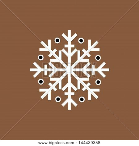 White and black winter snowflake on brown background. End of year christmas and sale season.