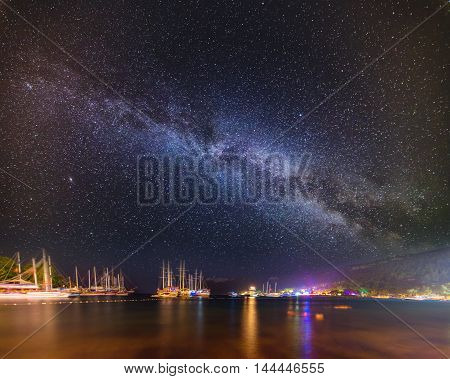 Night bay with ships in Kemer with milky way sky