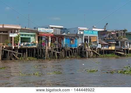 Mekong River Vietnam -- March 20 2016. Dilapidated shops along the banks of the Mekong River in Vietnam