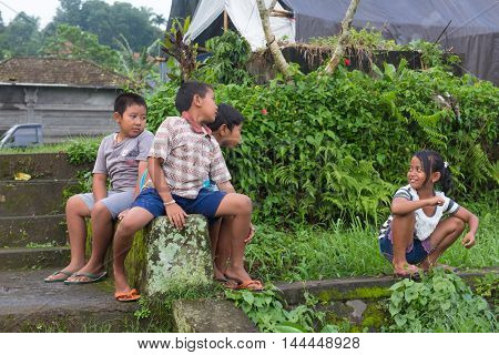 Jatiluwih Indonesia -- Feb 28 2016-- Village children playing outside near terraced rice paddies. Editorial Use Only.