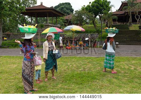Bali Indonesia -- February 28 2016--Women at outdoor market carrying produce. Editorial Use Only