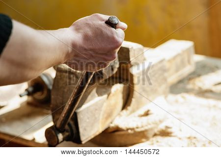 Worker securing a detail in a vise