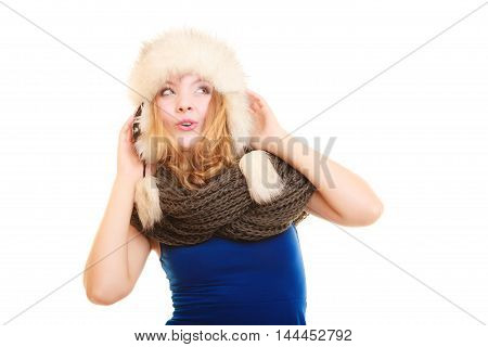 Winter fashion. Portrait positive teen girl in warm clothes. Happy young woman in fur hat doing fun isolated.